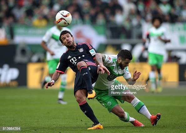 Vieirinha of Wolfsburg vies with Juan Bernat of Muenchen during the Bundesliga match between VfL Wolfsburg and FC Bayern Muenchen at Volkswagen Arena...