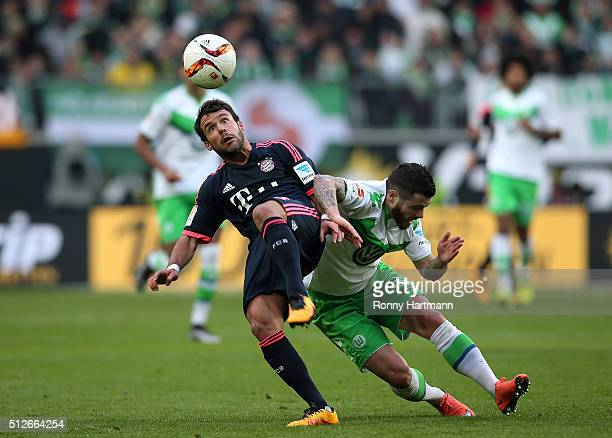 Vieirinha of Wolfsburg vies with Juan Bernat of Muenchen during the Bundesliga match between VfL Wolfsburg and FC Bayern Muenchen at Volkswagen Arena...