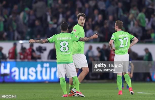 Vieirinha Philipp Wollscheid and Maximilian Arnold react after the Bundesliga Playoff first leg match between VfL Wolfsburg and Eintracht...