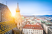 Aerial view over the rooftops of Vienna from the north tower of St. Stephen's Cathedral including the cathedral's famous ornately patterned, richly colored roof created by 230,000 glazed tiles, Austri