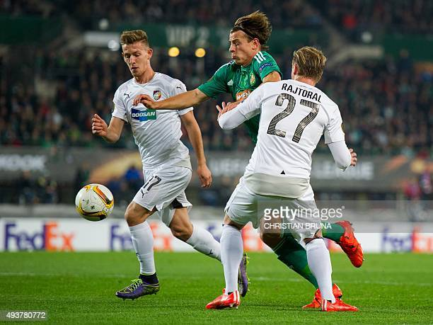 Vienna's Stefan Schwab and Pilzen's Frantisek Rajtoral fight for the ball during the UEFA Europa Leage football match SK Rapid Wien v FC Viktoria...