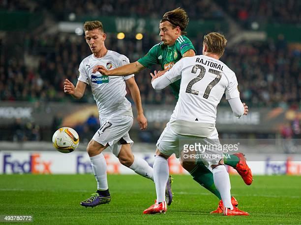 Vienna's Stefan Schwab and Pilzen's Frantisek Rajtoral fight for the ball during the UEFA Europa Leage football match SK Rapid Wien v FC Viktoria...