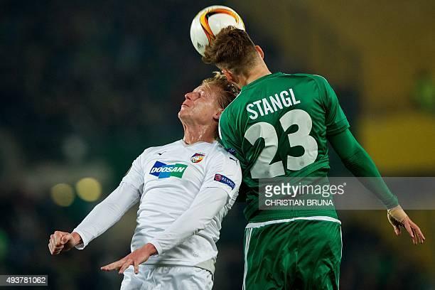 Vienna's Stefan Stangl and Pilzen's Frantisek Rajtoral jump for the ball during the UEFA Europa Leage football match SK Rapid Wien v FC Viktoria...