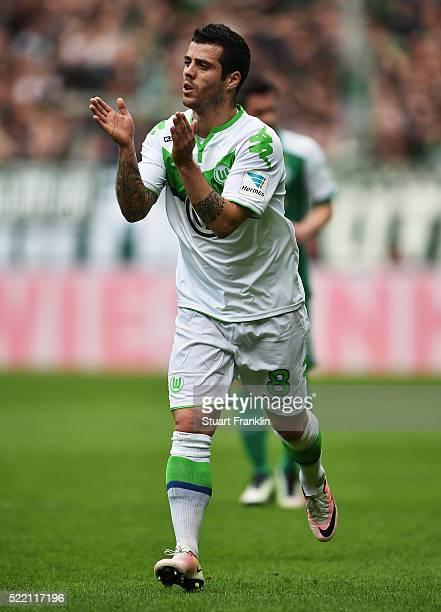 Vierinha of Wolfsburg claps during the Bundesliga match between Werder Bremen and VfL Wolfsburg at Weserstadion on April 16 2016 in Bremen Germany