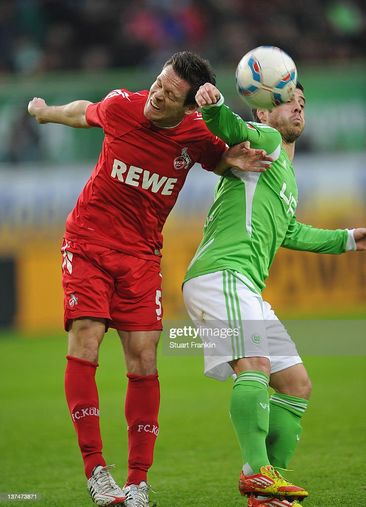 Vierinha of Wolfsburg is challenged by <a gi-track='captionPersonalityLinkClicked' href=/galleries/search?phrase=Sascha+Riether&family=editorial&specificpeople=614139 ng-click='$event.stopPropagation()'>Sascha Riether</a> of Koeln during the Bundesliga match between VfL Wolfsburg and 1. FC Koeln at Volkswagen Arena on January 21, 2012 in Wolfsburg, Germany.