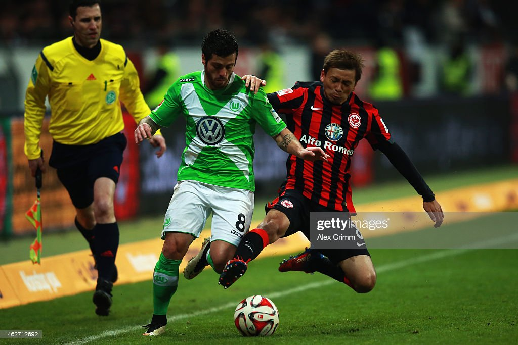 Vierinha (L) of Wolfsburg is challenged by <a gi-track='captionPersonalityLinkClicked' href=/galleries/search?phrase=Takashi+Inui&family=editorial&specificpeople=7174976 ng-click='$event.stopPropagation()'>Takashi Inui</a> of Frankfurt during the Bundesliga match between Eintracht Frankfurt and VfL Wolfsburg at Commerzbank-Arena on February 3, 2015 in Frankfurt am Main, Germany.