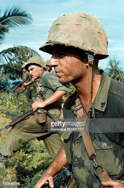 Viet Nam War in 1965 American solders in a burning village