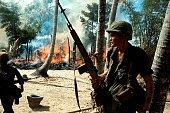 Viet Nam War in 1965 American soldiers in a burning village