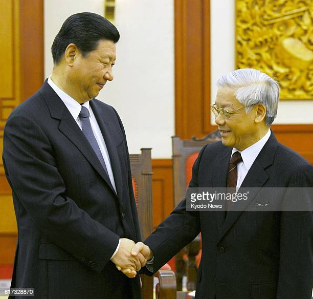 HANOI Vietnam Chinese Vice President Xi Jinping shakes hands with Vietnamese Communist Party General Secretary Nguyen Phu Trong at the party's...