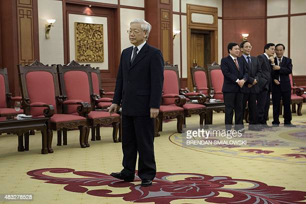 Vietnam Communist Party Secretary General Nguyen Phu Trong waits to greet US Secretary of State John Kerry before a meeting at the VCP headquarters...