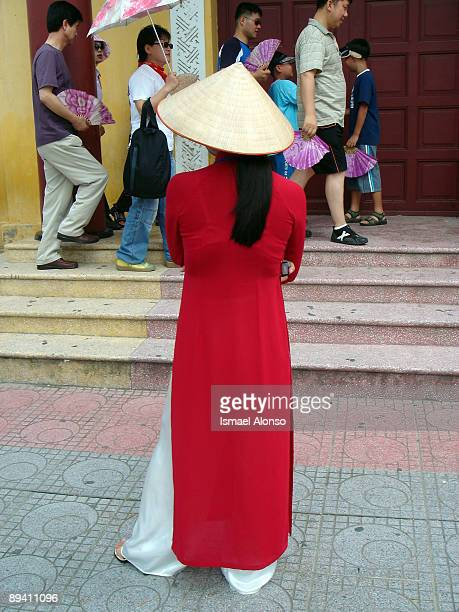 Vietnam Girl dressed with Ao Dai and Hanoi hat