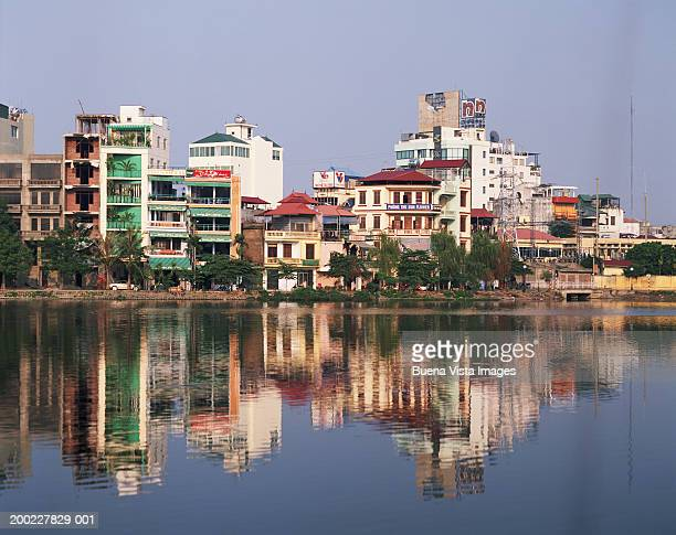 Vietnam, Hanoi skyline with reflection in river