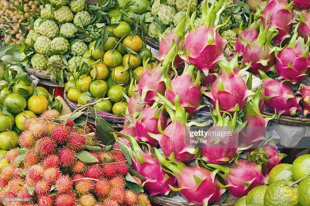 Vietnam, Ho Chi Minh City, tropical fruit at outdoor market : Stock Photo