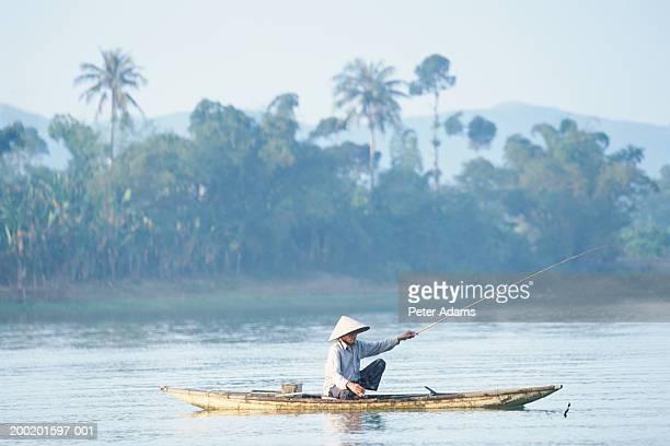 Vietnam, Hue, mature fisherman fishing in Perfume River
