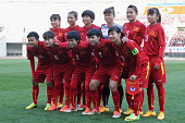 Vietnam players line up for the team photos prior to the AFC Women's Olympic Final Qualification Round match between Vietnam and North Korea at...