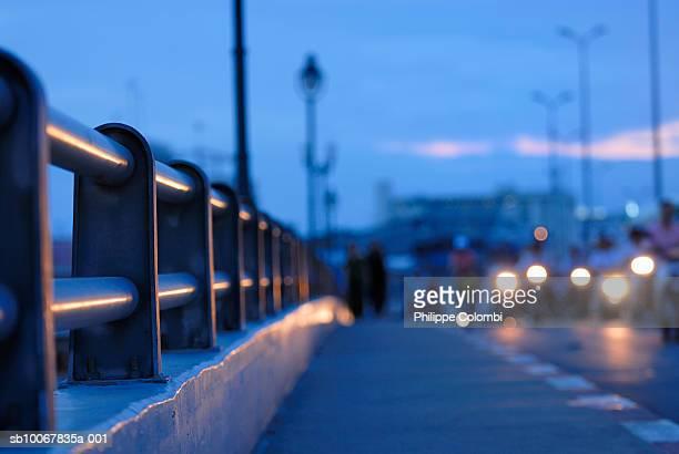 Vietnam, Saigon, Ho Chi Minh, motorcycle headlights on Ong Lanh bridge at dusk