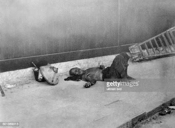 Vietnam Saigon man sleeping on the street