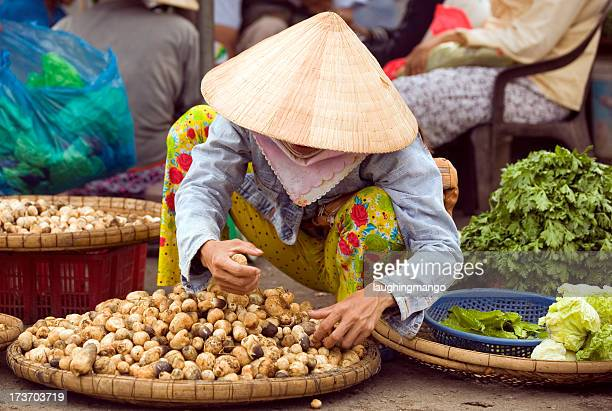 vietnam street market lady seller ho chi minh saigon