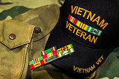 Vietnam Veterans Hat, Service Ribbons & Pouches On Camouflage Uniform