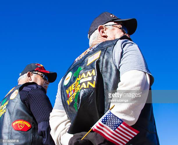 Vietnam Veterans With US Flag at Veterans' Day Memorial Service