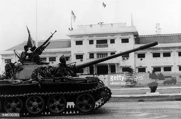 Vietnam War South Vietnam's surrender North Vietnamese military and the Vietcong invading Saigon A tank in front of the headquarter of the South...