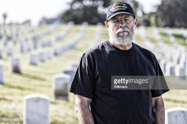 Vietnam War USA Navy Veteran Mourning at Military Cemetery