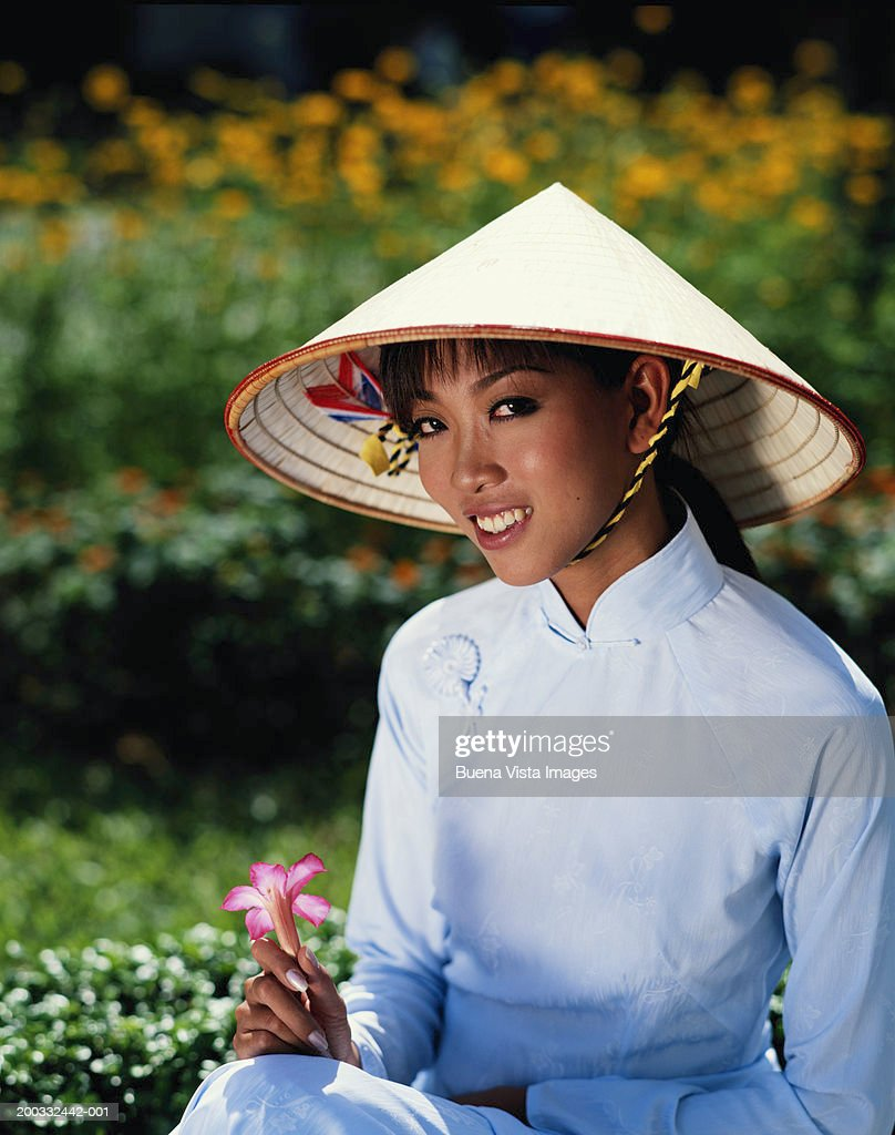 Vietnam, young woman wearing traditional dress and hat, portrait : Stock Photo