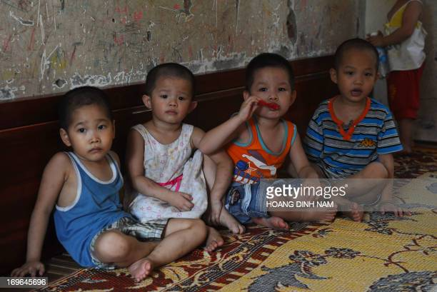 VietnamchildrendisabledFEATURE by Cat Barton This picture taken on May 28 2013 shows young children watching television inside a dormitory room at...