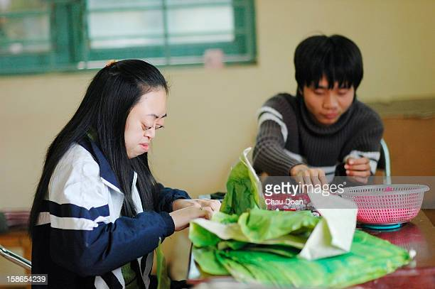 Vietnamese Agent Orange children victims make paper peach flowers inside the Ha Tay Peace Village 20km West of Hanoi ay Peace Village 20km West of...