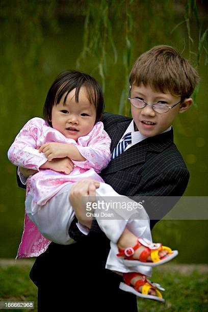 Vietnamese American boy and his Vietnamese half sister MODEL RELEASED