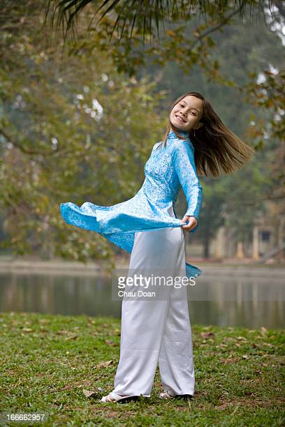 Vietnamese American teenage girl in traditional attire MODEL RELEASED