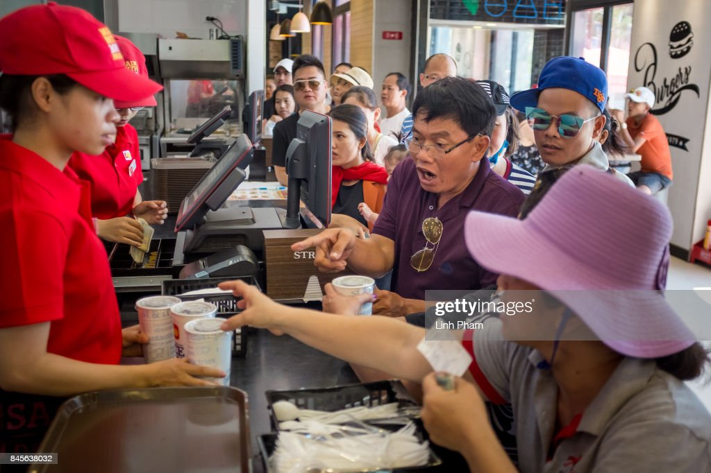 Vietnamese and Chinese tourists scramble for food at a fast-food restaurant in Vinpearl Land Amusement Park on September 8, 2017 in Nha Trang, Vietnam. With a total of 2.7 million tourists in 2016, China is Vietnam's largest source of visitors, as most mainland Chinese head to the coastal cities of Da Nang or Nha Trang located in the centre of the country and famed for their beaches, historical sights and seafood. Based on reports, Chinese tour groups have grown to 150 to 200 while the influx has caused problems such as the lack of Chinese speaking staff and inexperience in dealing with inappropriate behavior by the mainland Chinese who have been criticized for their lack of manners in public spaces, including spitting and urinating in public and being noisy at religious places and heritage sites. As Vietnamese travel agencies aim to improve service for Chinese tourists, local media have reported the illegal use of the Renminbi in local markets and Chinese agents and guides acting without proper authorization, leading to distortions in how Vietnam's history and culture have been presented.