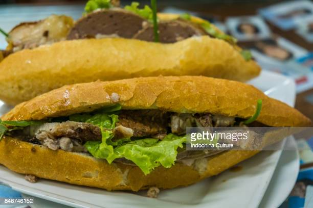 Vietnamese Banh Mi with pork roll. traditional street food of Vietnam
