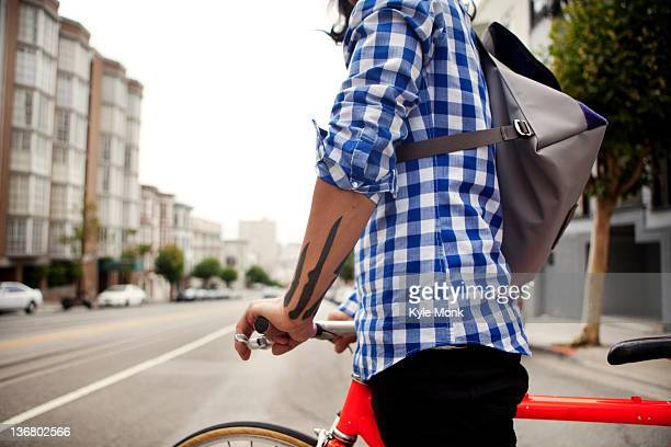 Vietnamese bicycle messenger on city street