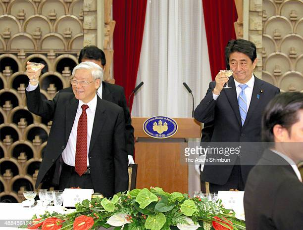 Vietnamese Communist Party Leader Nguyen Phu Trong and Japanese Prime Minister Shinzo Abe toast glasses during the dinner at Abe's official residence...