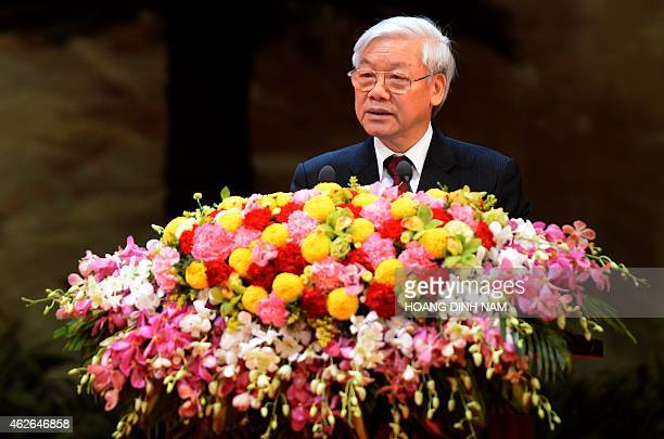 Vietnamese Communist Party Secretary General Nguyen Phu Trong delivers a speech at an official meeting on the eve of the party's 85th foundation...