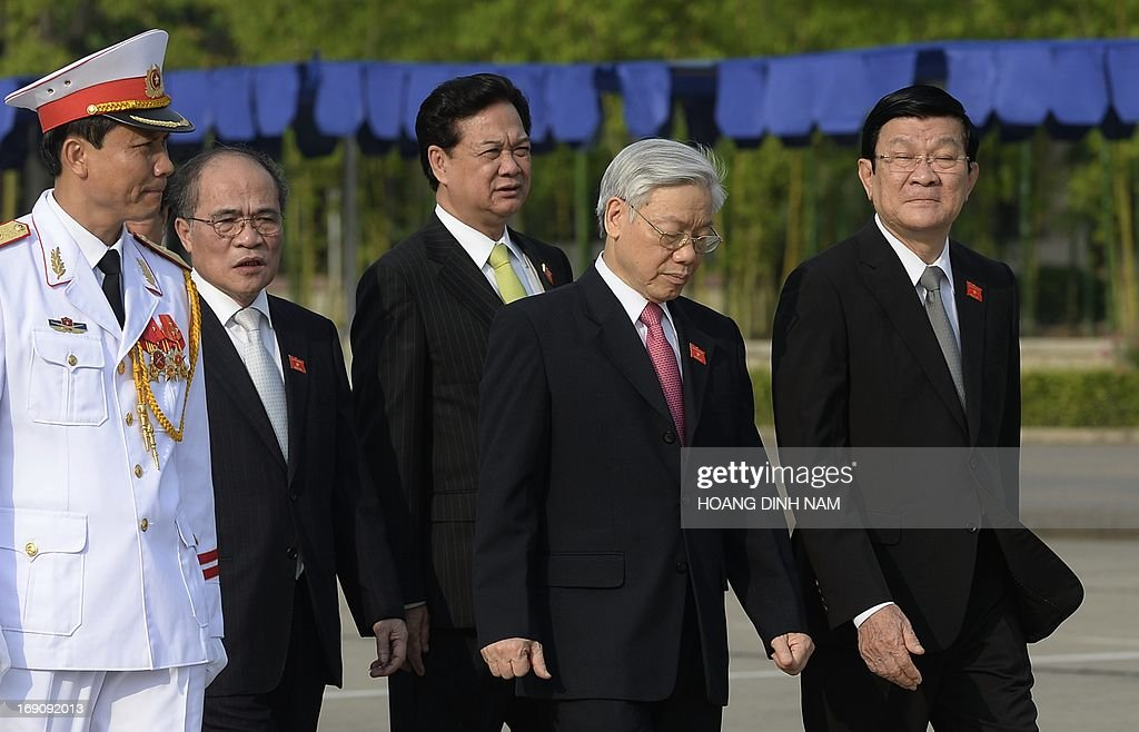 Vietnamese Communist Party Secretary General Nguyen Phu Trong (2nd R), president Truong Tan Sang (1st R), Prime Minister Nguyen Tan Dung (C) and Chairman of the National Assembly Nguyen Sinh Hung (2nd L) lead deputies to pay hommage to late president Ho Chi Minh, at his mausoleum prior to the opening of the one-month-long summer session of the National Assembly in Hanoi on May 20, 2013 . AFP PHOTO/HOANG DINH Nam