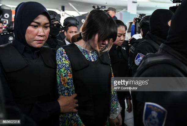 Vietnamese defendant Doan Thi Huong is escorted by police personnel towards the lowcost carrier Kuala Lumpur International Airport 2 in Sepang during...