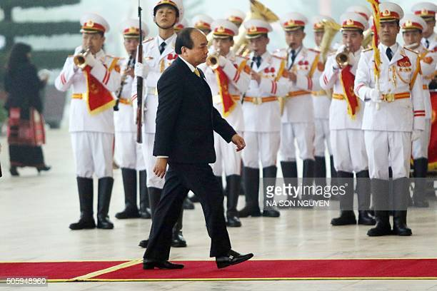 Vietnamese Deputy Prime Minister Nguyen Xuan Phuc arrives for the opening ceremony of the 12th National Congress of Vietnam's Communist Party in...