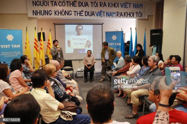 Vietnamese dissident blogger with dual French citizenship Pham Minh Hoang attends a community meeting on June 25 2017 in an hotel of the Paris...