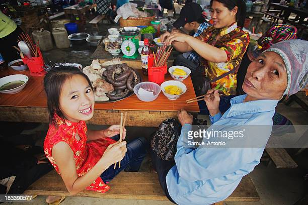 CONTENT] Vietnamese family eating in a food stall at the Bac Ha Market in Bac Ha Vietnam People Food and Drink Food Horizontal Vietnam Southeast Asia...
