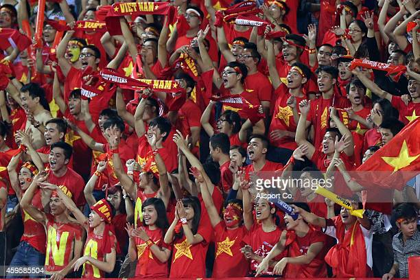 Vietnamese fans cheer during the 2014 AFF Suzuki Cup Group A match between Laos and Vietnam at the My Dinh Stadium on November 25 2014 in Hanoi...