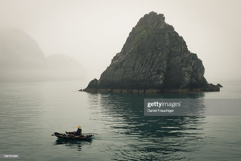 CONTENT] Vietnamese fisherman rowing in the Halong Bay, Vietnam. March 6, 2011.