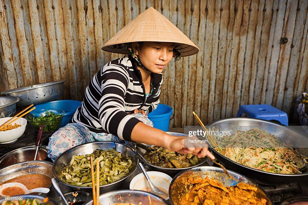 Vietnamese food vendor on local market : Stock Photo