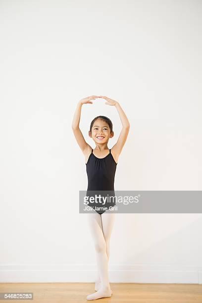 Vietnamese girl posing during ballet lesson