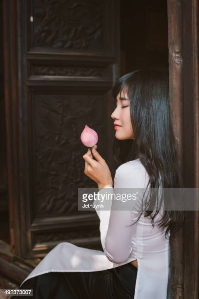 Vietnamese Girl with ao dai and lotus.