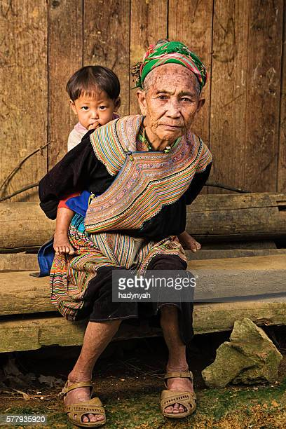 Vietnamese grandmother from Flower Hmong Tribe with her granddaughter