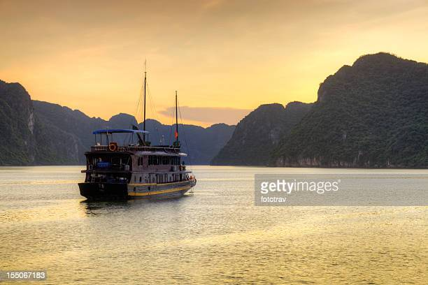 Vietnamese Junk cruising Halong Bay, Hanoi Vietnam sunset