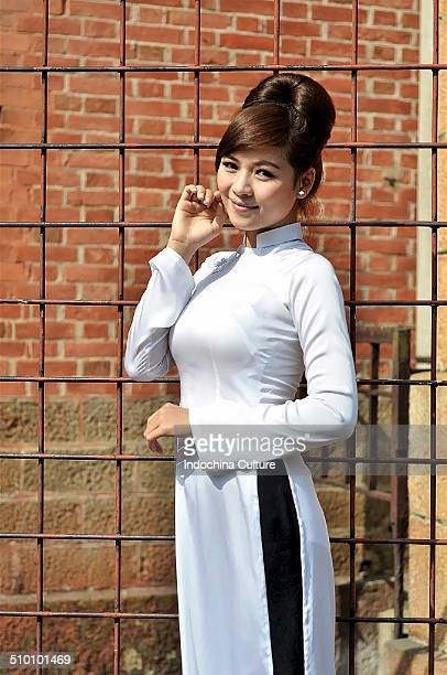 Vietnamese lady in traditional long dress (Ao dai)