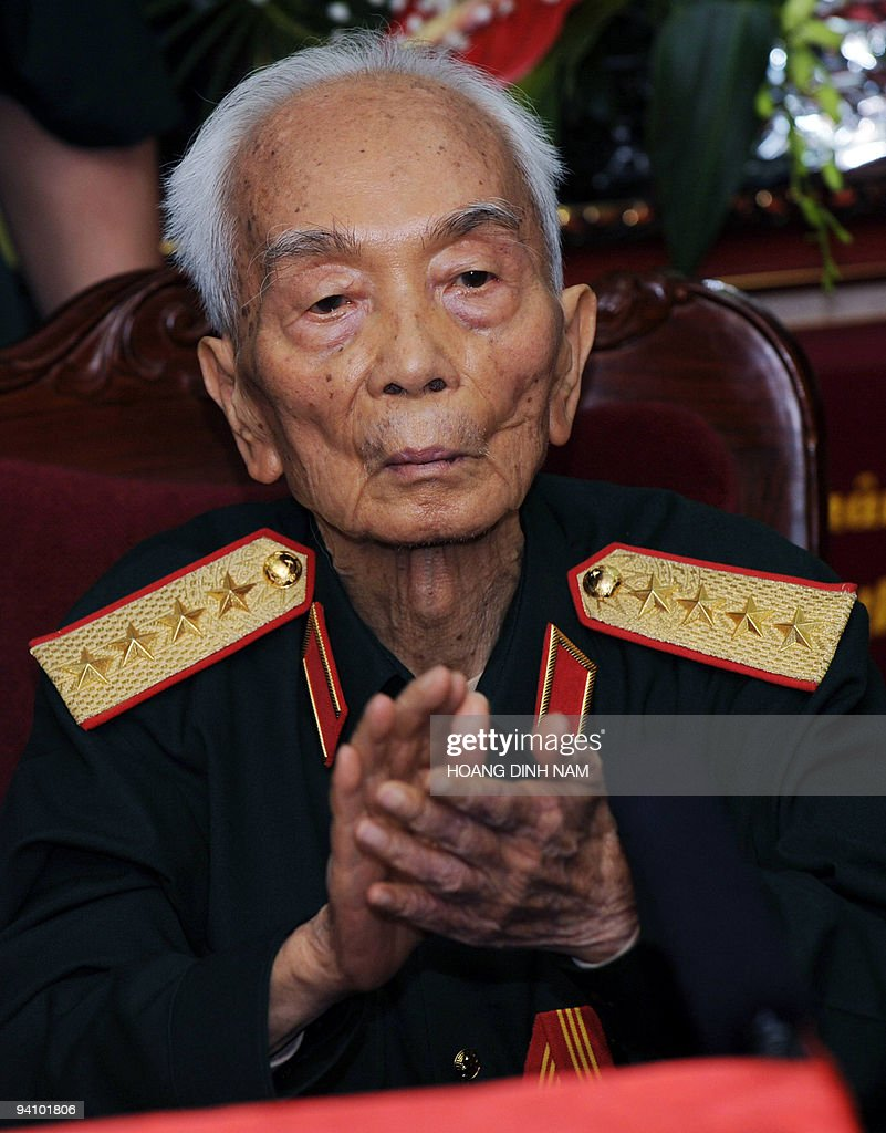Vietnamese legendary retired general Vo Nguyen Giap applauds during a private meeting held to mark the 60th anniversary of his nomination as Vietnam's communist army's first general at his residence in Hanoi on May 28, 2008. The 97-year-old general led Vietnamese troops in the famous defeat of the French army during the 56-day-long battle at Dien Bien Phu in May 1954, putting an end to French colonial occupation. AFP PHOTO/HOANG Dinh Nam